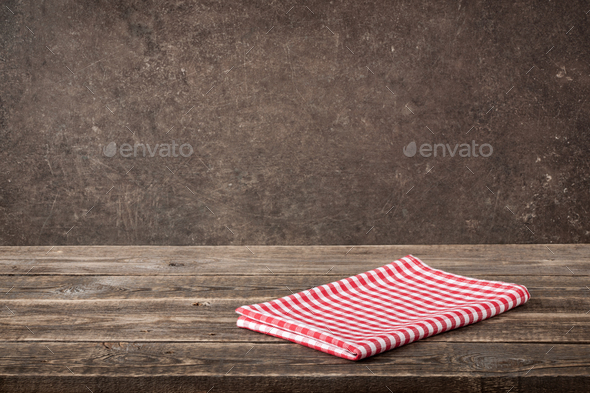 Red-white checkered napkin on wooden table - Stock Photo - Images