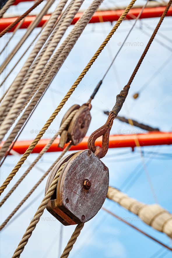 Picture of old sailing ship wooden pulley. - Stock Photo - Images
