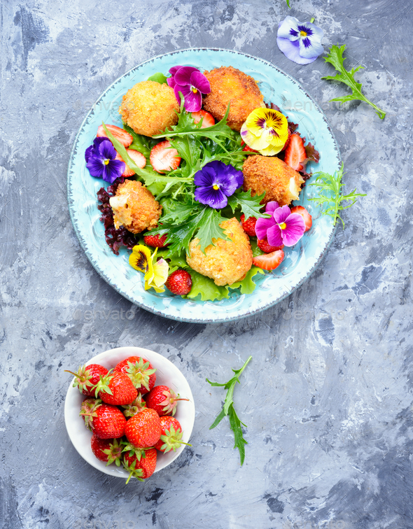Salad leaves with strawberries,herbs and flowers - Stock Photo - Images