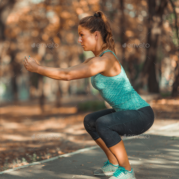 Woman Exercising Outdoor in The Fall - Stock Photo - Images