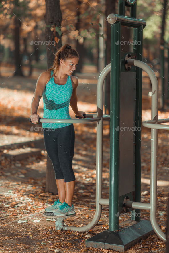 Woman Exercising In Outdoor's Gym in The Fall - Stock Photo - Images