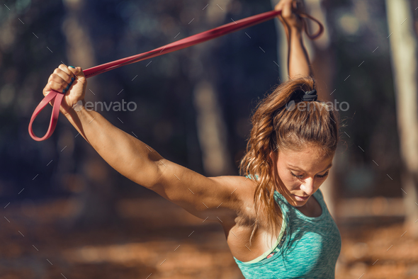 Woman Exercising With Elastic Band Outdoors in The Fall - Stock Photo - Images