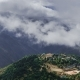 The Movement of Clouds Over the Valley and Mountain Village in the Himalayas - VideoHive Item for Sale
