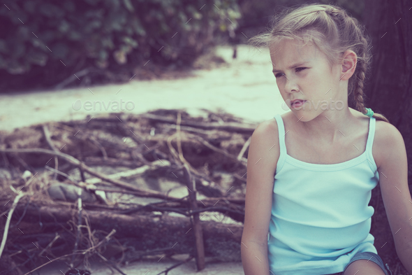 Portrait of one sad little girl. - Stock Photo - Images