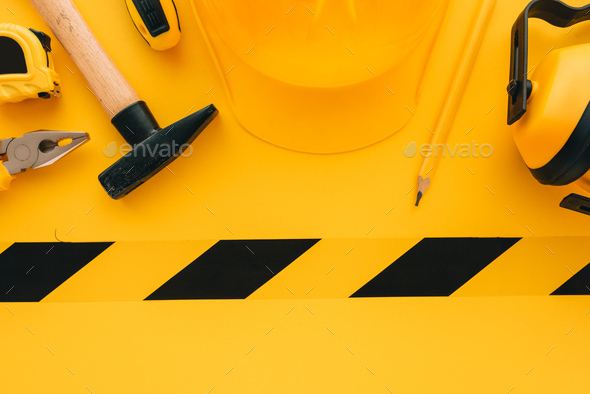 Under construction concept with yellow protective helmet and too - Stock Photo - Images