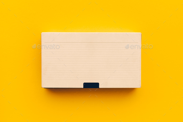 VHS video cassette on yellow background - Stock Photo - Images
