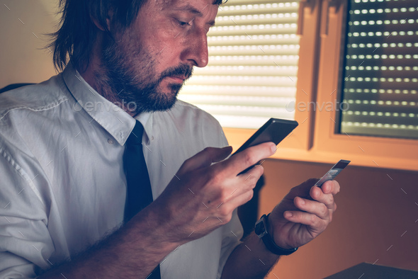 Businessman using mobile banking services app to purchase online - Stock Photo - Images