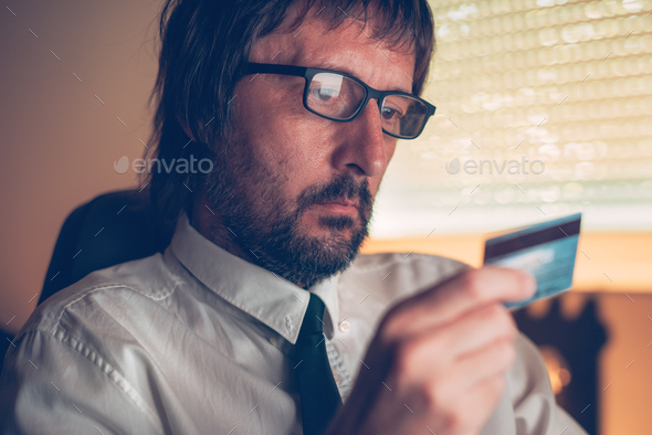 Businessman shopping online with debit payment card - Stock Photo - Images