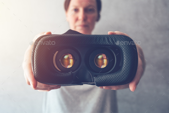 Woman offering VR headset - Stock Photo - Images