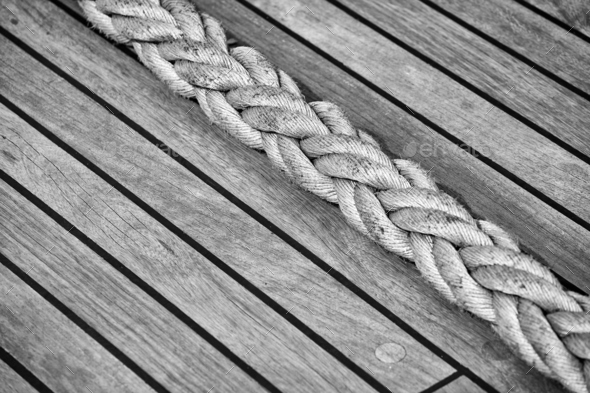 Thick rope on an old sailing ship wooden deck. - Stock Photo - Images