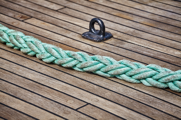 Rope on an old sailing ship wooden deck. - Stock Photo - Images