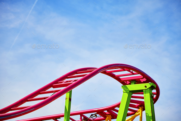 Roller coaster pink tracks in an amusement park. - Stock Photo - Images