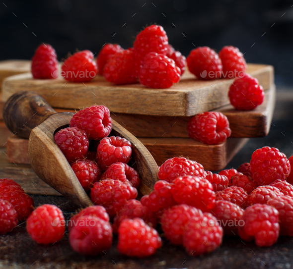 Fresh raspberries on a dark background - Stock Photo - Images