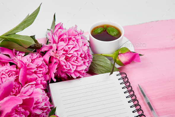 Beautiful pink peony flowers with note. - Stock Photo - Images