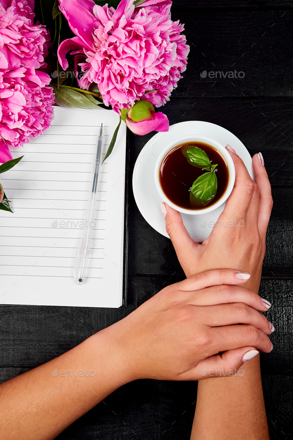 Woman hand writing diary with coffee - Stock Photo - Images