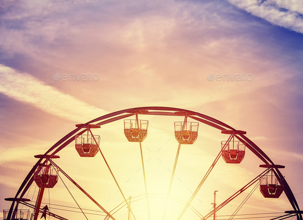 Picture of a Ferris wheel at sunset. - Stock Photo - Images