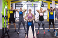 athletes doing exercises with kettlebells - PhotoDune Item for Sale