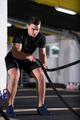 athlete man doing battle ropes cross fitness exercise - PhotoDune Item for Sale