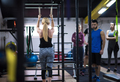 woman working out with personal trainer on gymnastic rings - PhotoDune Item for Sale