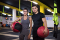 young athletes couple working out with medical ball - PhotoDune Item for Sale