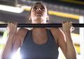 woman doing pull ups on the horizontal bar - PhotoDune Item for Sale