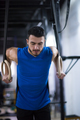 man working out pull ups with gymnastic rings - PhotoDune Item for Sale