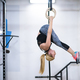 woman working out on gymnastic rings - PhotoDune Item for Sale