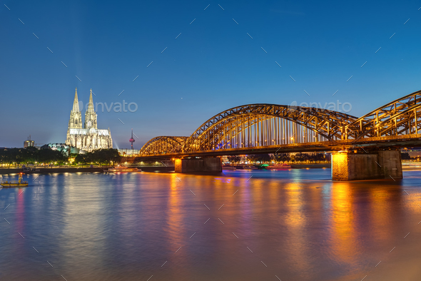 The famous Cologne Cathedral and the Hohenzollern railway bridge - Stock Photo - Images