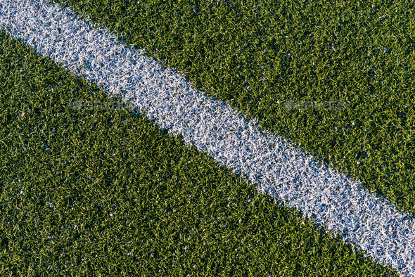White line on a green artificial soccer field - Stock Photo - Images