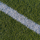 White line on a green artificial soccer field - PhotoDune Item for Sale