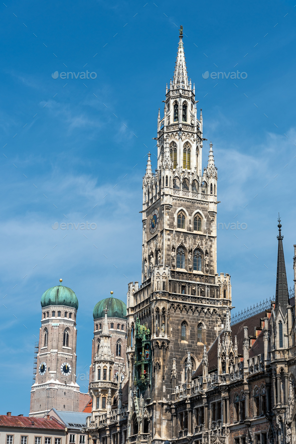 The towers of the New City Hall and the famous Frauenkirche at the Marienplatz  - Stock Photo - Images