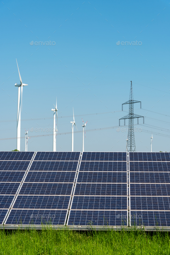 Electricity pylons, solar panels and wind engines - Stock Photo - Images