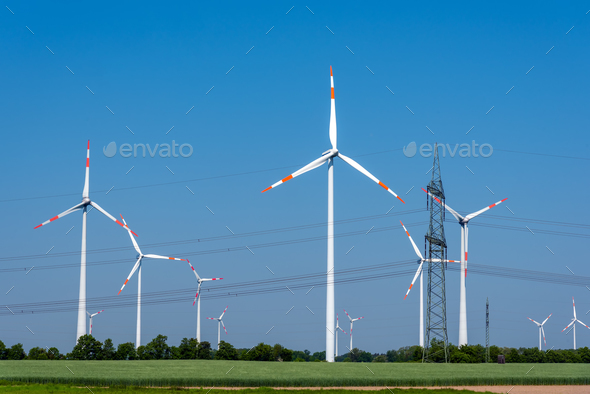 Overhead power lines and wind power plants  - Stock Photo - Images