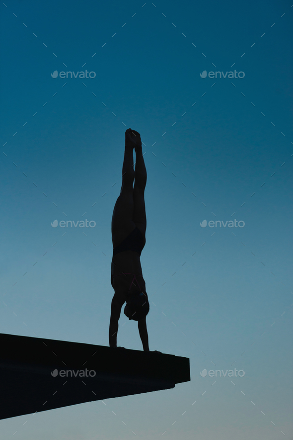 Handstand diver on board - Stock Photo - Images