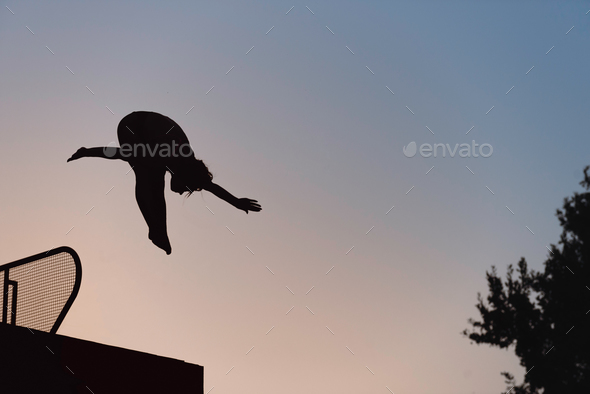 Jump into the pool in dusk - Stock Photo - Images