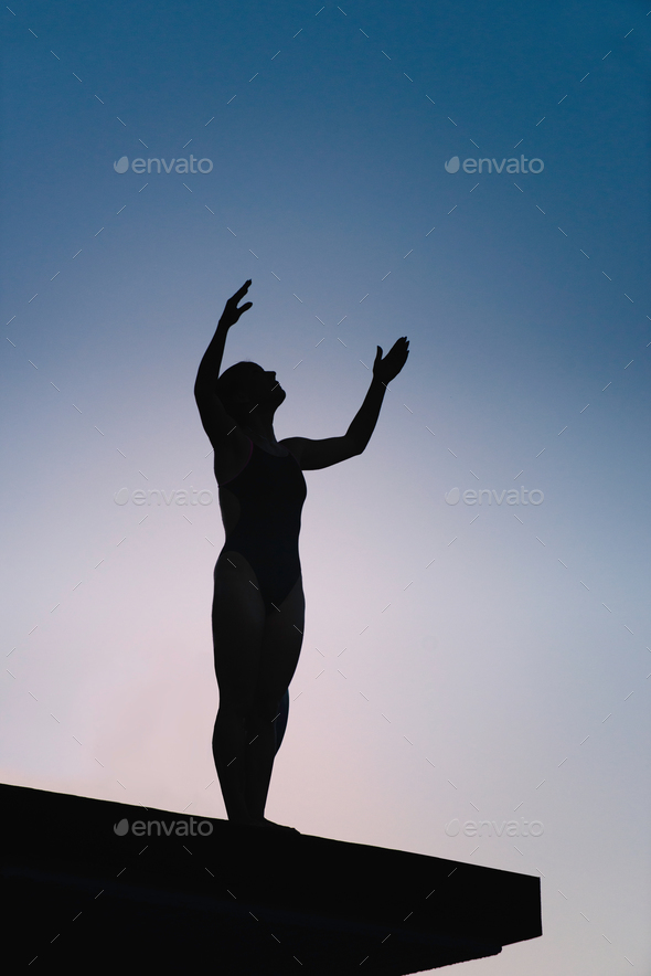 Female with arms outstreched on board - Stock Photo - Images
