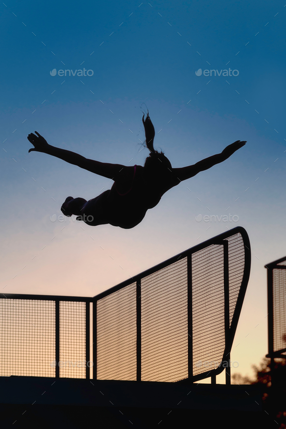 Jump from diving board in dusk - Stock Photo - Images