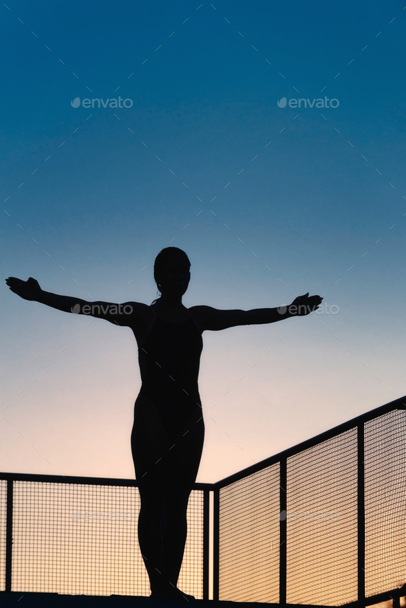 Female ready to jump from board - Stock Photo - Images