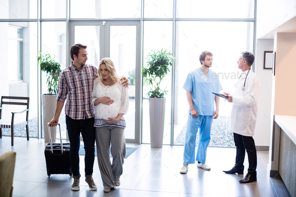 Couple interacting with each other in hospital - Stock Photo - Images