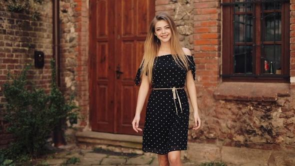 Beautiful Girl In Black Dress Walking Along The Street Street Old