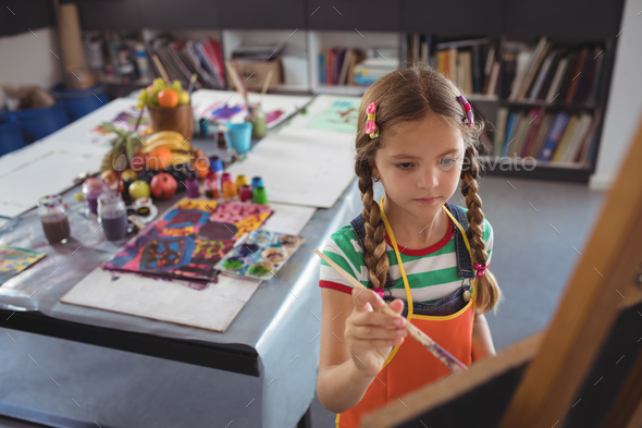 High angle view of girl painting on canvas - Stock Photo - Images