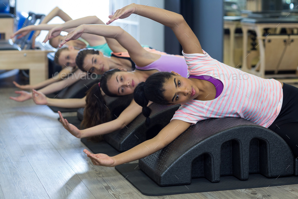 Group of women exercising on arc barrel - Stock Photo - Images