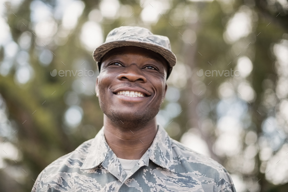 Close-up of happy military soldier - Stock Photo - Images