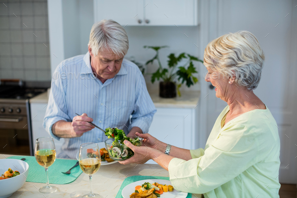 Senior couple having meal together - Stock Photo - Images
