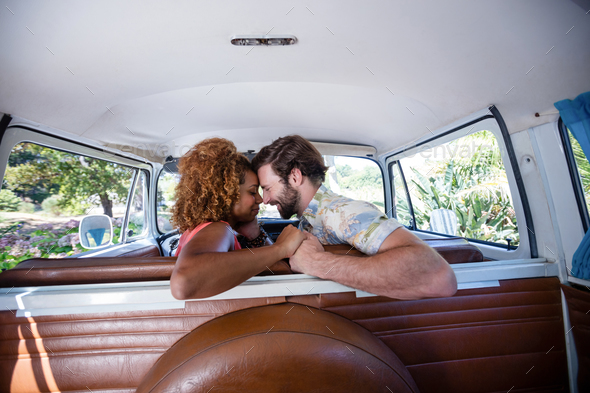 Couple holding hands in campervan - Stock Photo - Images