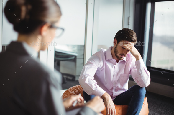 Unhappy man consulting counselor - Stock Photo - Images