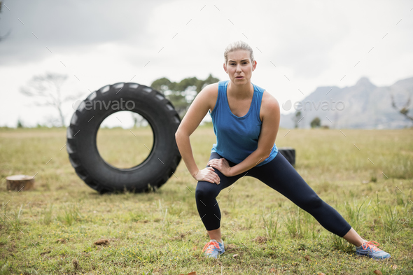 Fit woman performing stretching exercise - Stock Photo - Images