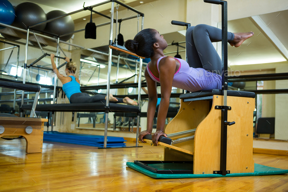 Woman exercising on wunda chair - Stock Photo - Images
