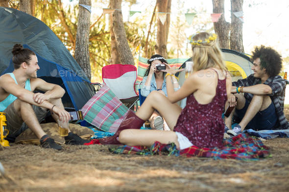 Young friends enjoying at campsite - Stock Photo - Images