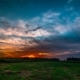 Sunset  Clouds Floating Over Green Summer Field - VideoHive Item for Sale